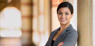 hispanic woman getting a scholarship